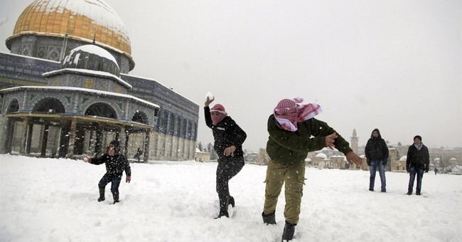AP PHOTOS: Deep freeze in eastern US, snow in Middle East