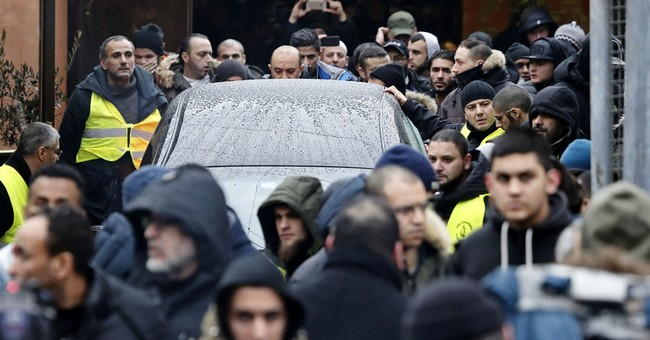 Hundreds reportedly attend burial for Danish Muslim gunman