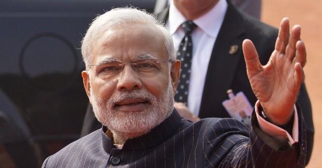 Modi's monogrammed suit raises nearly $700,000 at auction