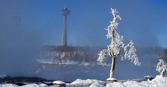 'Frozen' Niagara Falls drawing tourists to winter spectacle