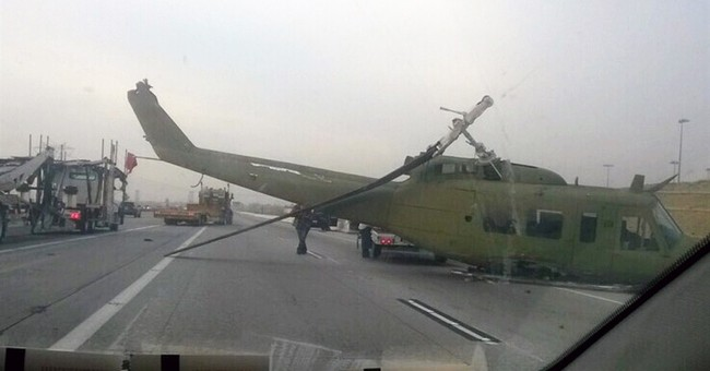 Helicopter being towed by truck tumbles into freeway traffic