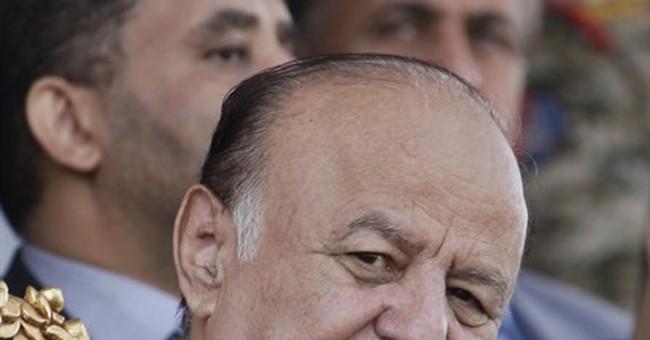 Yemen leader says still president after fleeing capital