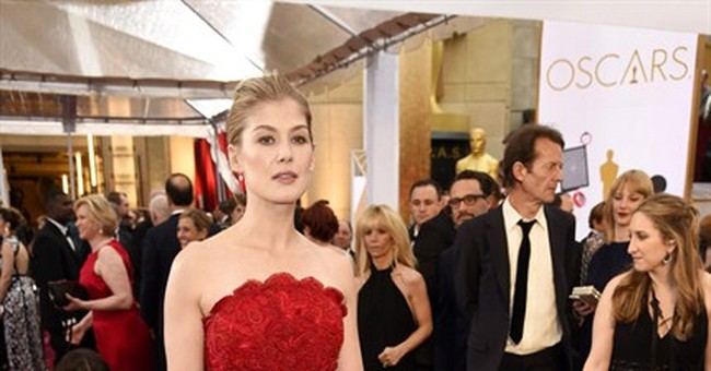 High collars and demure gowns on the Oscars red carpet