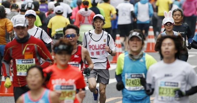 AP PHOTOS: Running police keep the peace at Tokyo Marathon