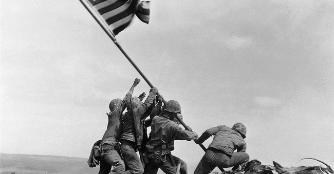 AP WAS THERE: 70 years ago, Marines raise  flag on Iwo Jima