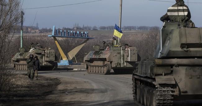Ukraine delays heavy weapons pullback, blames rebel attacks