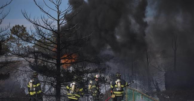 Tanker truck with 8K gallons of fuel crashes, catches fire