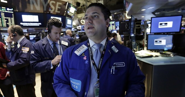 US stocks edge lower, pulling Dow back from a record high