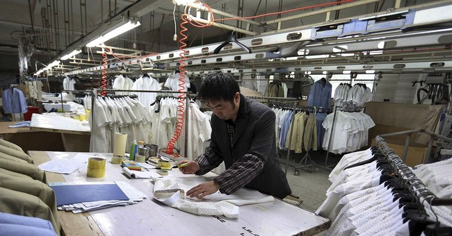 Survey: China factory activity up but export orders drop
