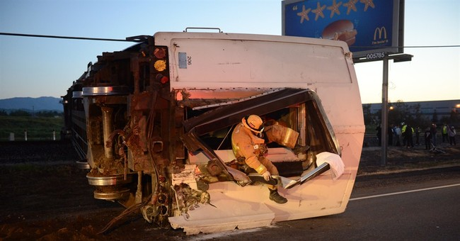 No charges yet for pickup driver in train crash 'mistake'