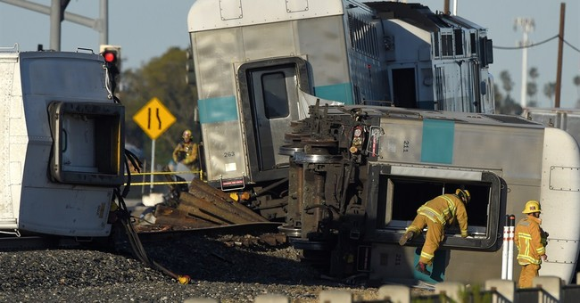 Abandoned truck's driver arrested after commuter train crash