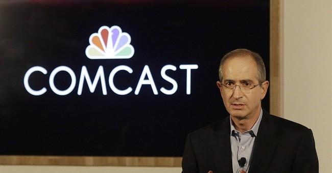 Comcast 4Q profit edges up, adds customers, boosts dividend
