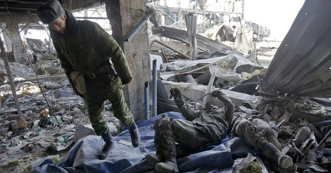 Ukrainian POWs dig out bodies of comrades killed at airport