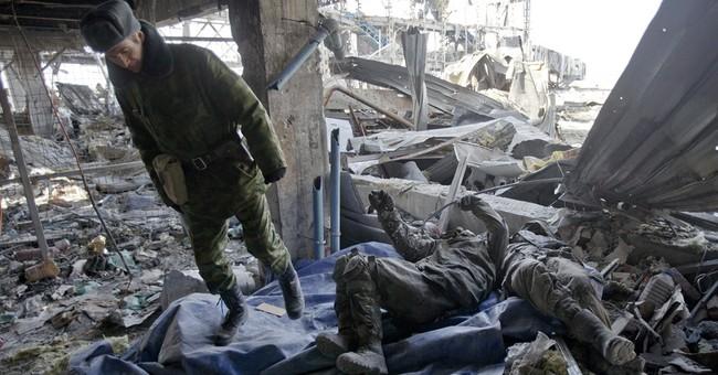 Ukrainian POWs dig out bodies of comrades killed at airport