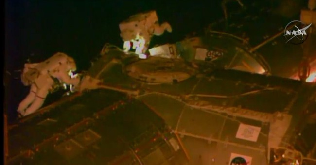Spacewalking astronaut safe after water leaks into helmet