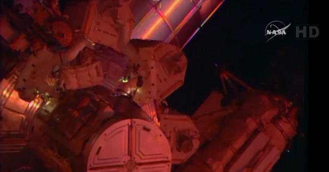 Spacewalking astronaut safe after water leaks into helmet
