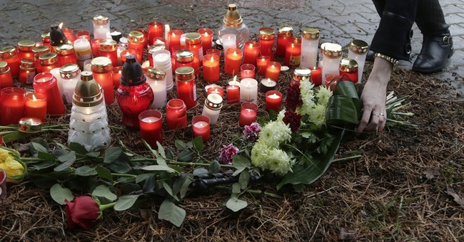 Residents in Czech town honor 8 killed in shooting