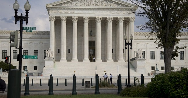 New charges for group that disrupted Supreme Court