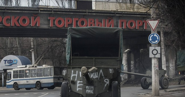 Ukraine, rebels start pulling back heavy weapons in the east