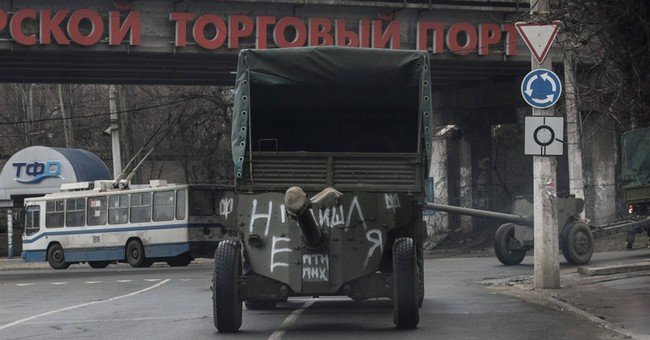 Ukraine, rebels start pulling back heavy weapons in the east