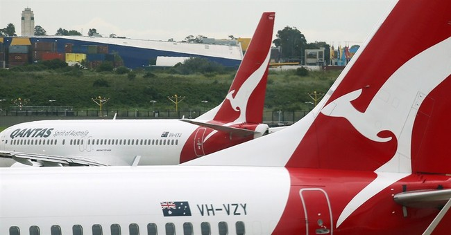 Qantas rebounds from loss to post $162 M half-year profit