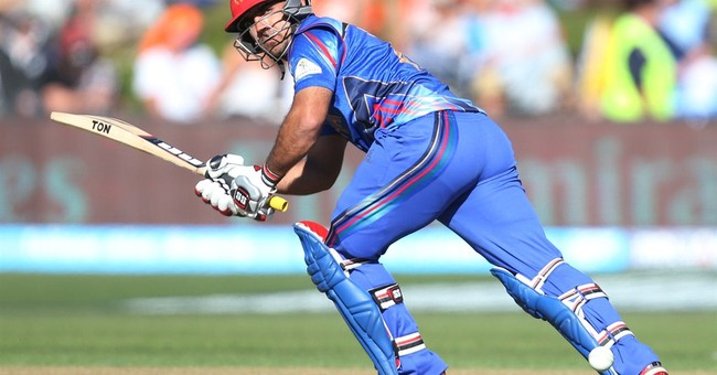 Afghanistan edges Scotland by 1 wicket for 1st World Cup win
