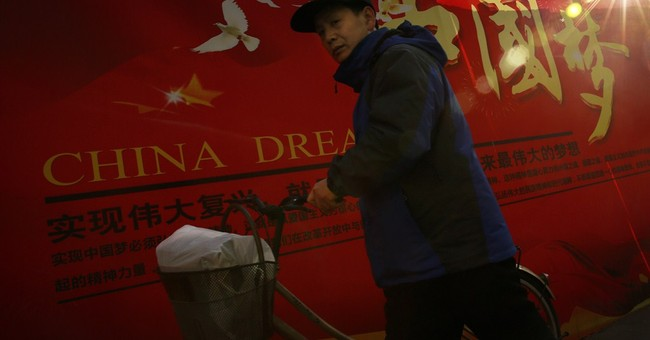 With new slogan, Chinese leader sets goals, keeps tradition