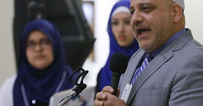 Anti-Islamic protesters shout at Muslims at Oklahoma Capitol
