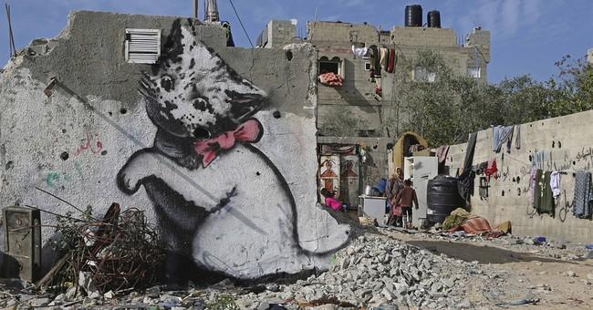 Mysterious graffiti artist Banksy illustrates Gaza debris