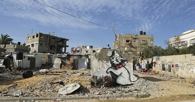 Mysterious graffiti artist Banksy illustrates Gaza debris