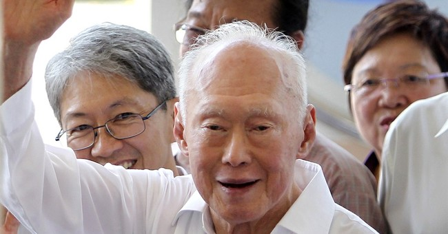 Singapore founding father Lee's condition improves slightly