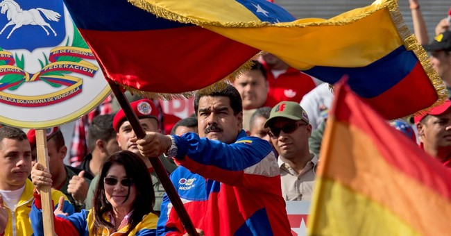 Maduro rejects speculation he'll suspend Venezuela elections