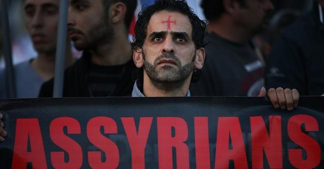 Activists say al-Qaida fighters overrun Syrian rebel bases