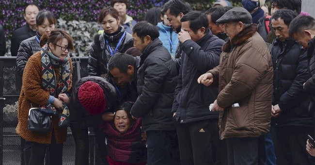 As families grieve, China manages public emotions