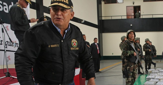 Popular Peru ex-minister charged in killing of journalist