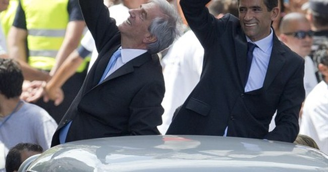 Elegant Vazquez replaces folksy Mujica as Uruguay president