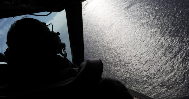 No plane, many discoveries in yearlong search for Flight 370