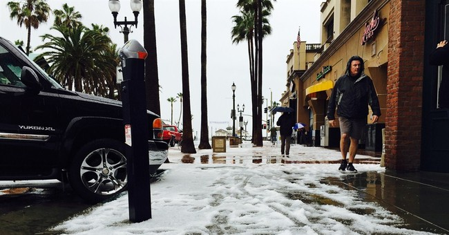 Southern California beach turned white by hail from storm