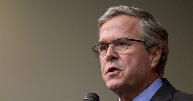 Jeb Bush distances himself from family