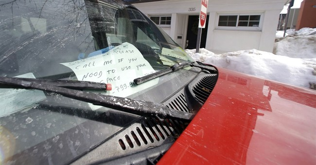 Snowy Boston starts removing parking-space savers