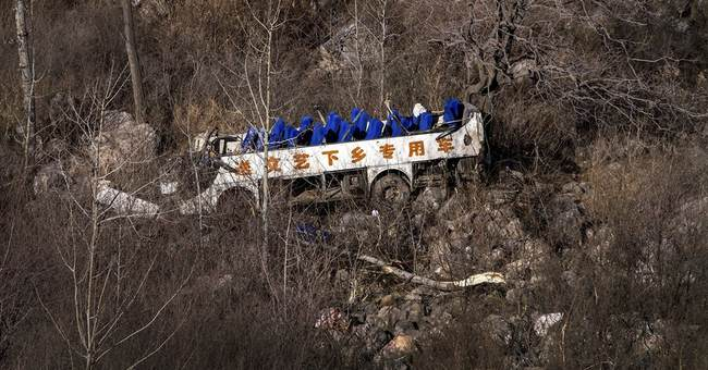 Bus carrying China opera troupe falls off cliff, killing 20