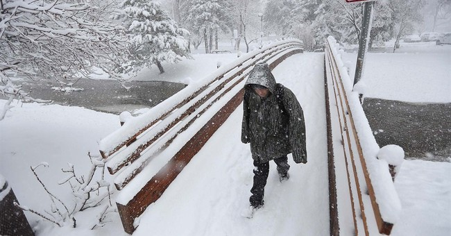Fast-moving storm dumps snow in parts of Upper Midwest
