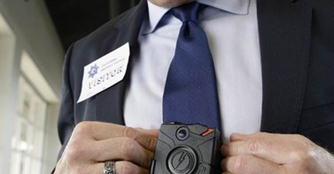 Body-camera maker has financial ties to police chiefs