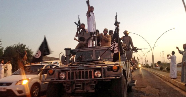 AP ANALYSIS: US on sidelines of key Iraqi battle against IS
