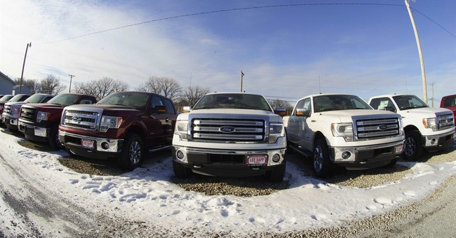 Auto industry slows for bad weather, but stays on course