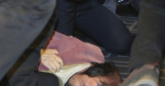 Knifed US envoy to Seoul in pain as officials investigate