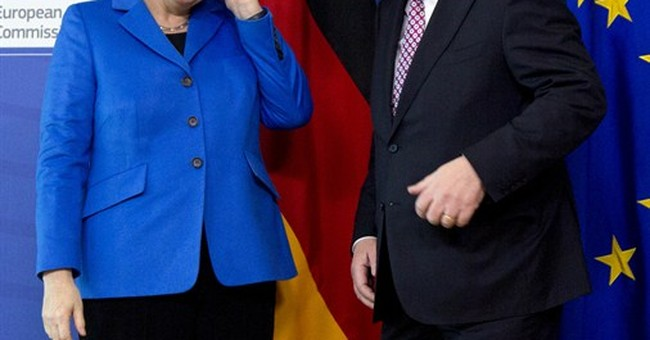 Merkel warns Russia to live up to Ukraine peace deal