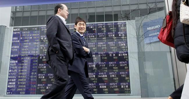 Global stocks mixed as investors eye European, US data