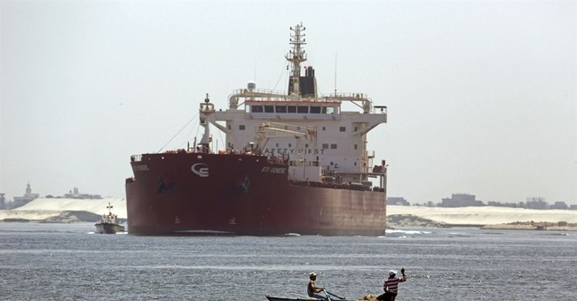 Egyptians race to expand Suez Canal, hoping for trade surge
