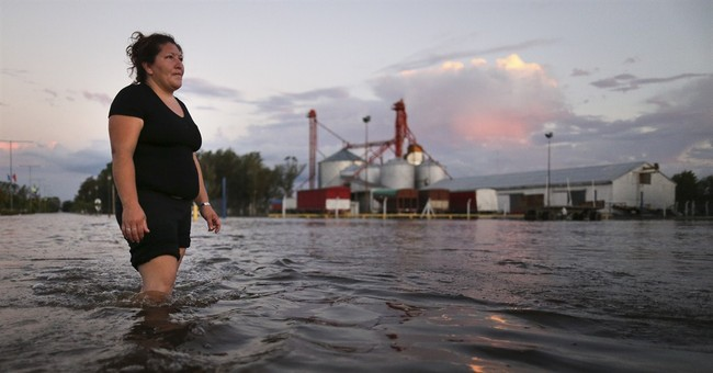 12 die, thousands evacuated in Argentine flooding